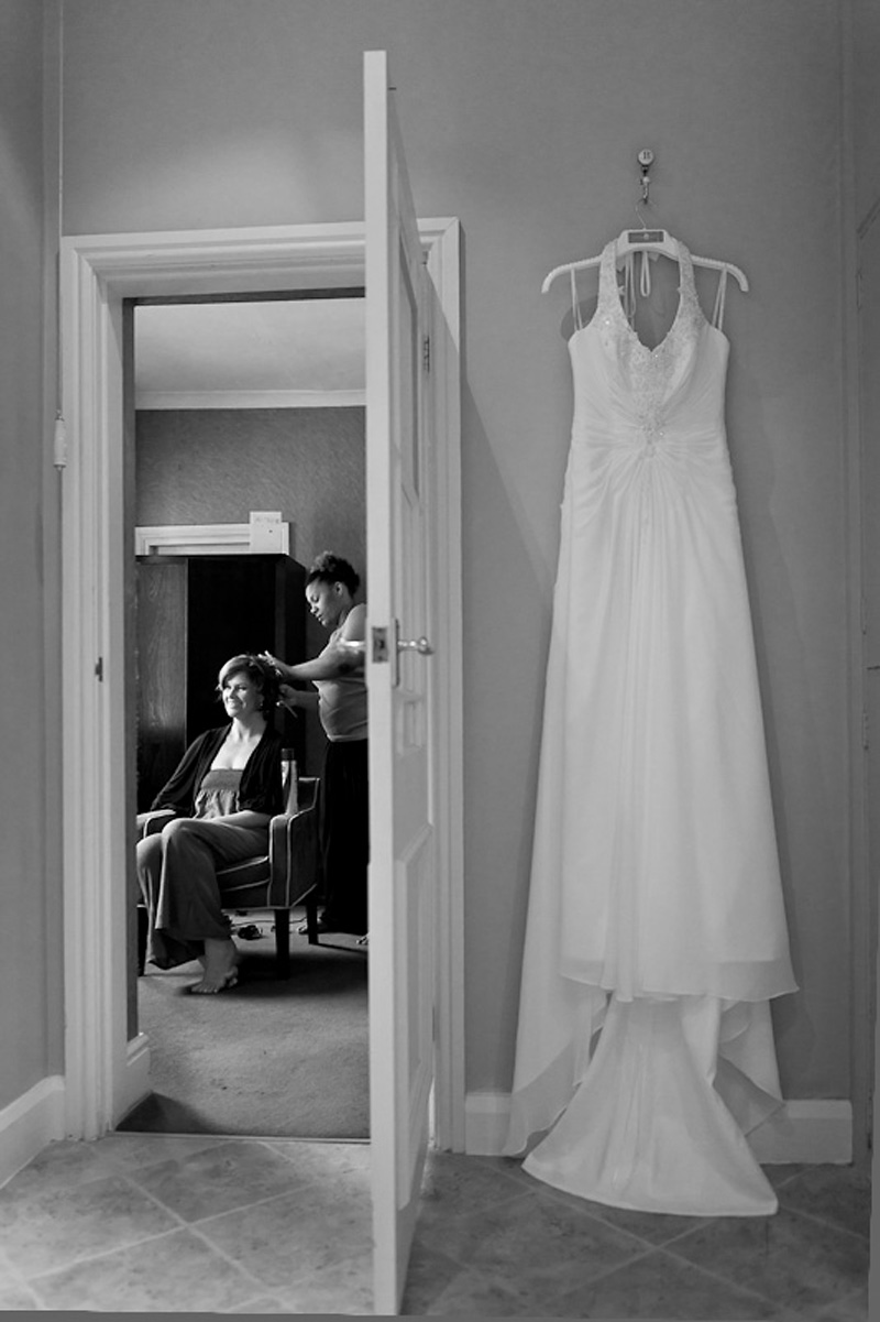 Wedding dress as bride as her hair styled