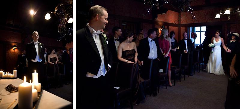 Groom looks back at Bride walking down the aisle