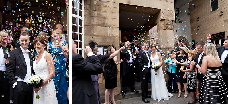 Bride and Groom showered with bubbles from guests