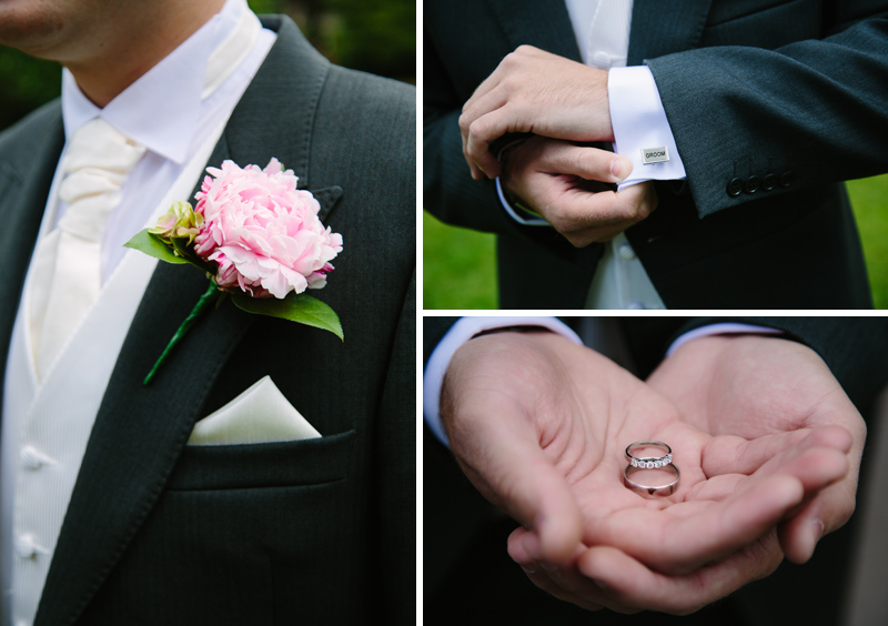Groom holds wedding rings