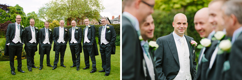 Groom with groomsmen in grounds of church