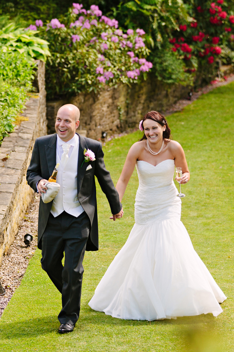 Bride and Groom walking and drinking champagne