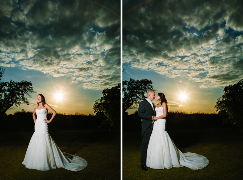 Bride and Groom hold hands while the sun sets behind them