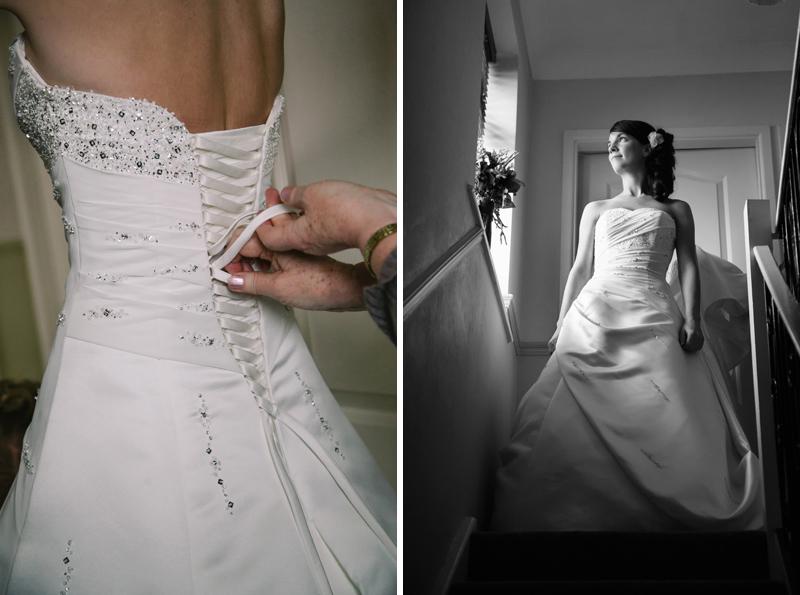 Brides mum fastening her daughters wedding dress