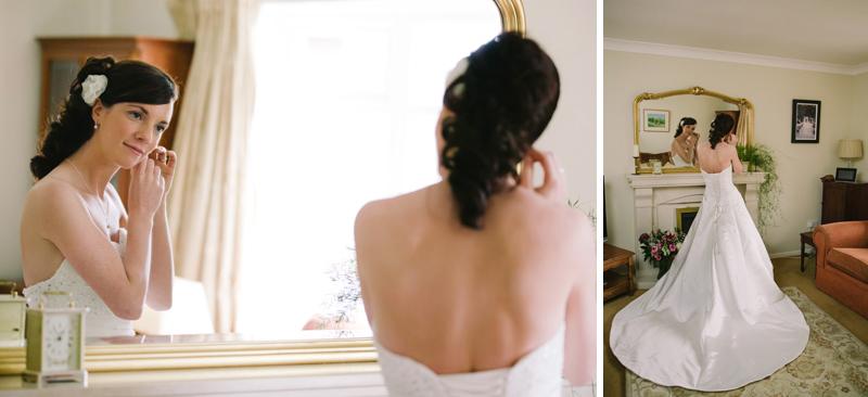 Bride adjusts her earings