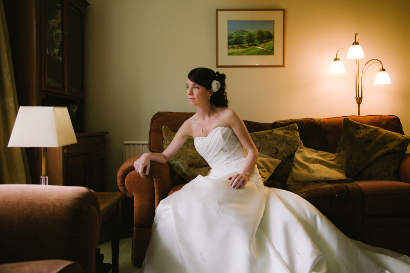 Bride sitting on the sofa thinking