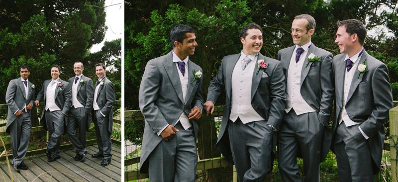 Groom and his groomsmen laughing