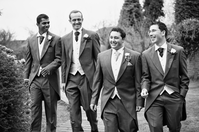 Groom and the groomsmen make their way to the ceremony