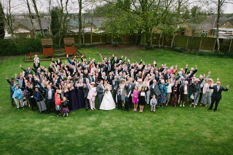 Bride and Groom with their guests waving