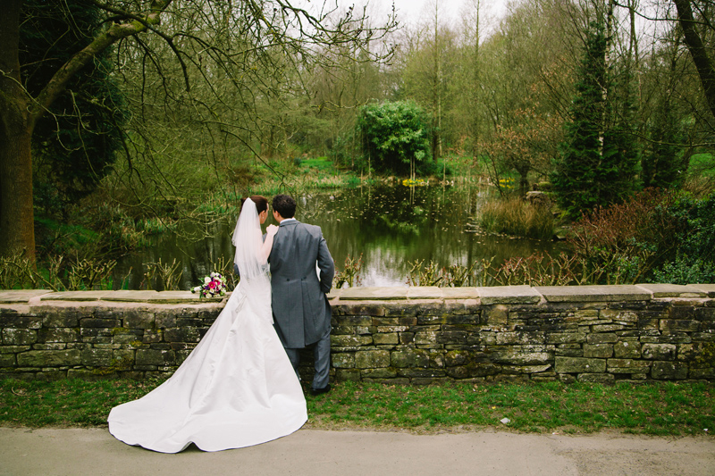 Bride and Groom having a chat while looking over the lake
