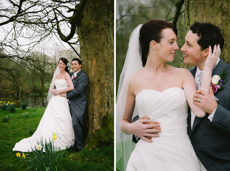 Bride and Groom cuddling by a tree