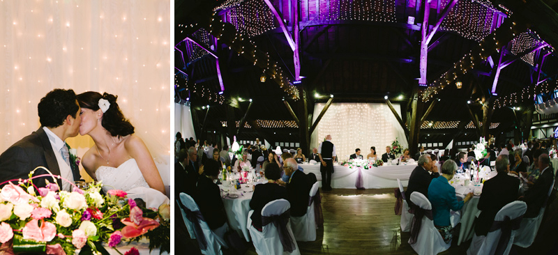 Bride and Groom kiss at wedding breakfast table as the meal is served