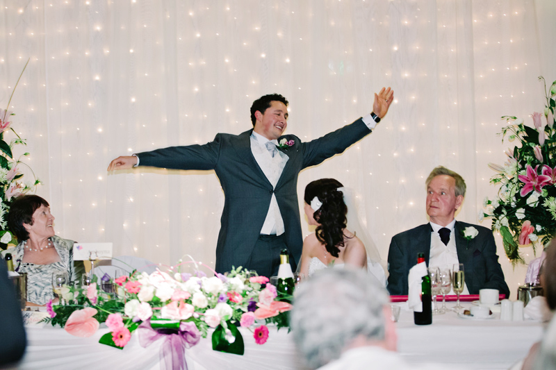The Groom sings during his speech