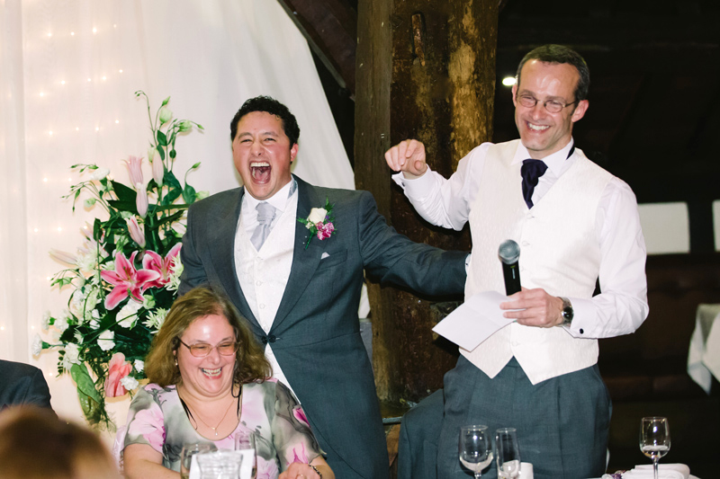 The Groom and Best Man laugh
