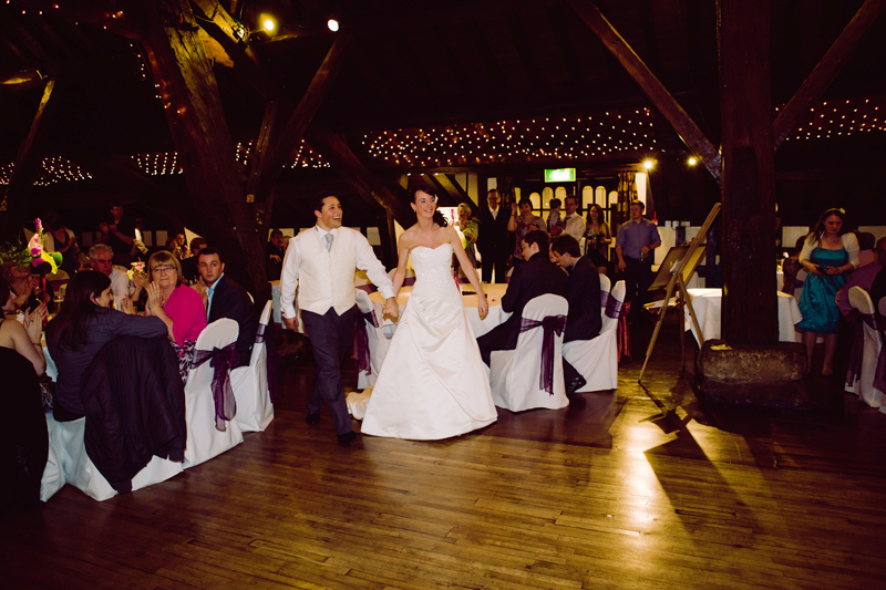 Bride and Groom walk onto the dance floor for their first dance