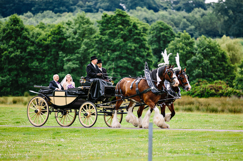 Bride and her father arrive at Capesthorne Hall in a horse and carriage