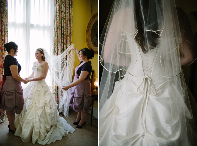 Back of brides dress with veil