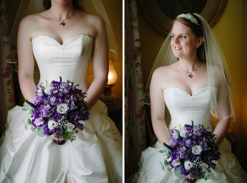 Bride looks out of window holding her bouquet
