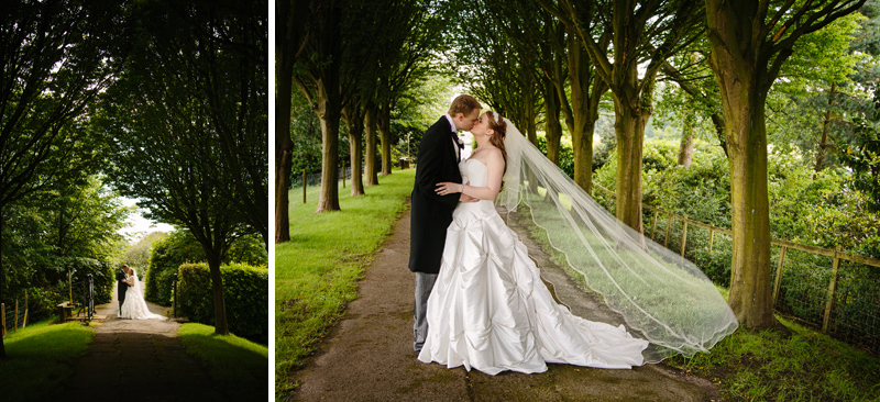 Bride and Groom walk down a tree lined path