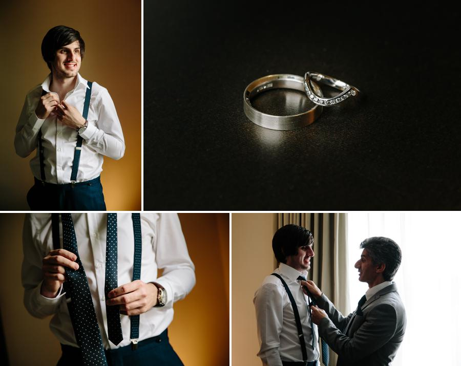 Groomsmen helping the groom with his tie
