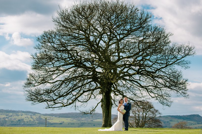 Bride and groom with the Tree at Heaton House Farm