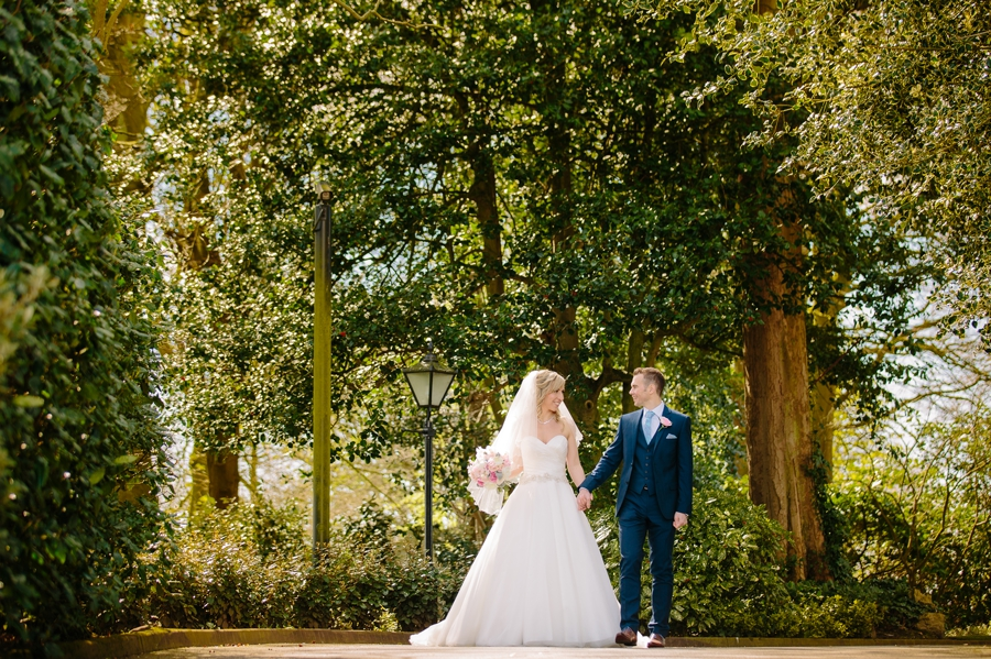 Bride and groom walking together in the sun