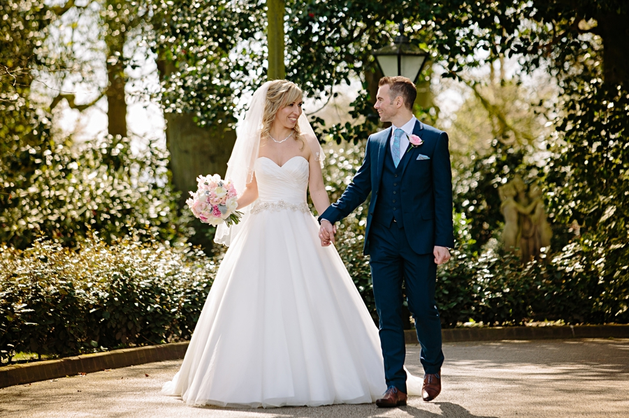 Bride and groom laughing in the sun