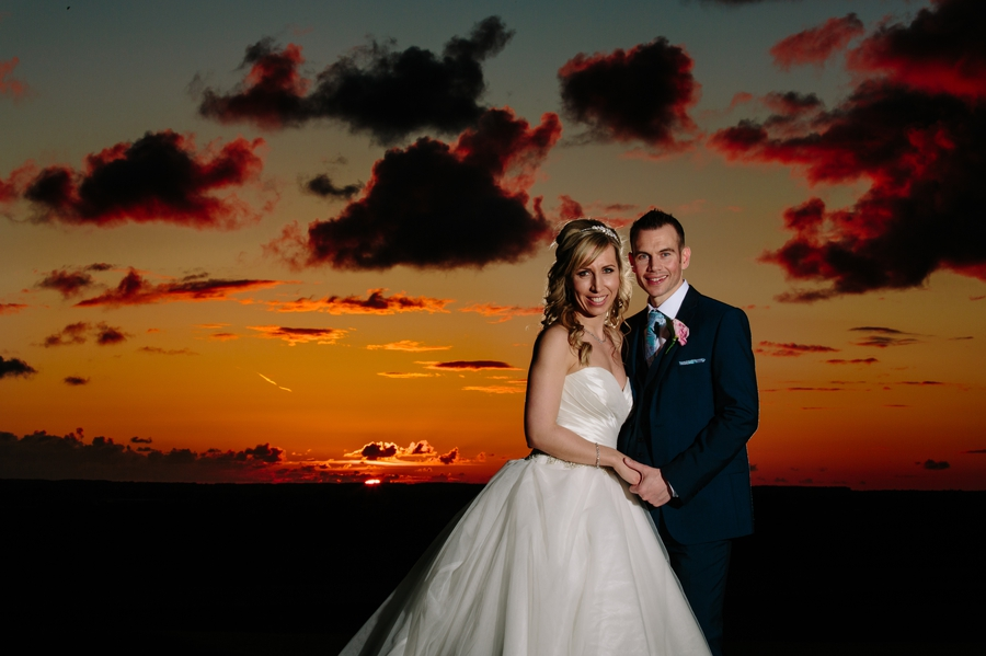 West tower sunset with the bride and groom