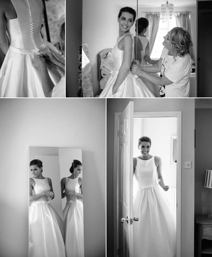 The Mother of the Bride helping her daughter put on her wedding dress