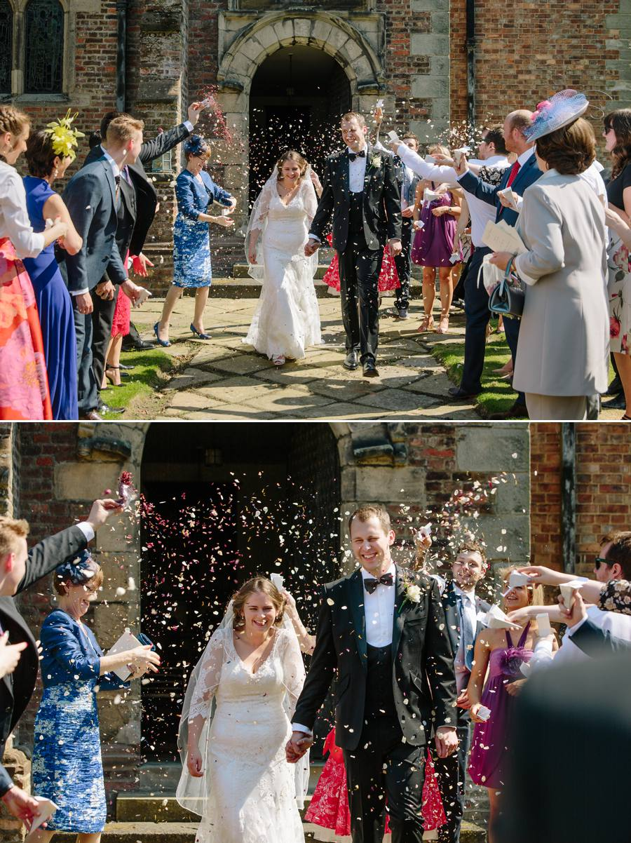 Bride and groom getting showered in Confetti as they exit the chapel