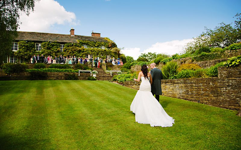 Bride and Groom walking in the garden at Hilltop