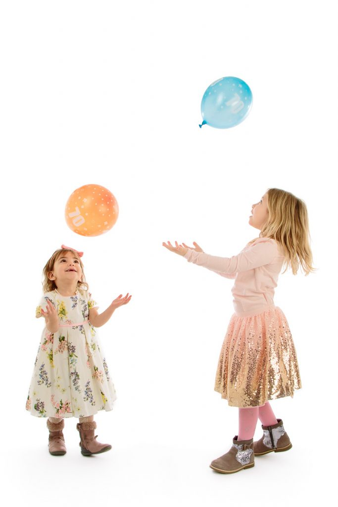 Girls playing with balloons in Studio