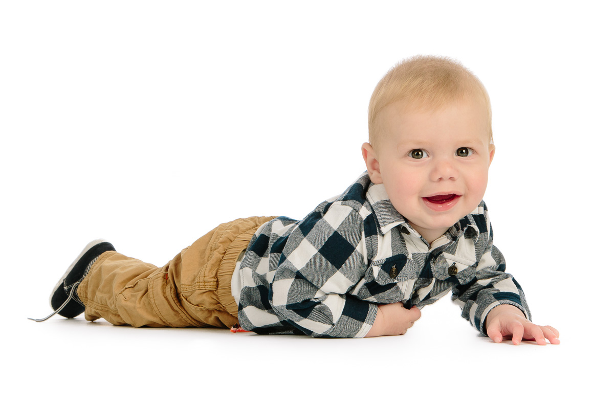 Cute toddler in studio crawling