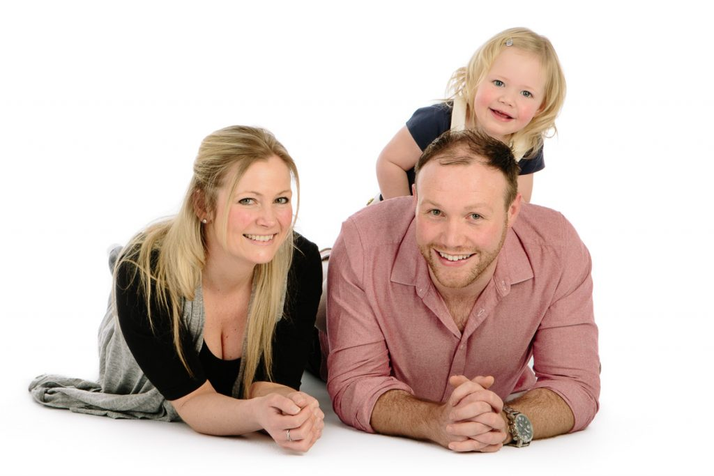 Family laughing and having fun in studio photoshoot