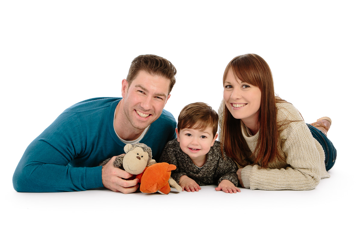 Family having fun in studio photoshoot