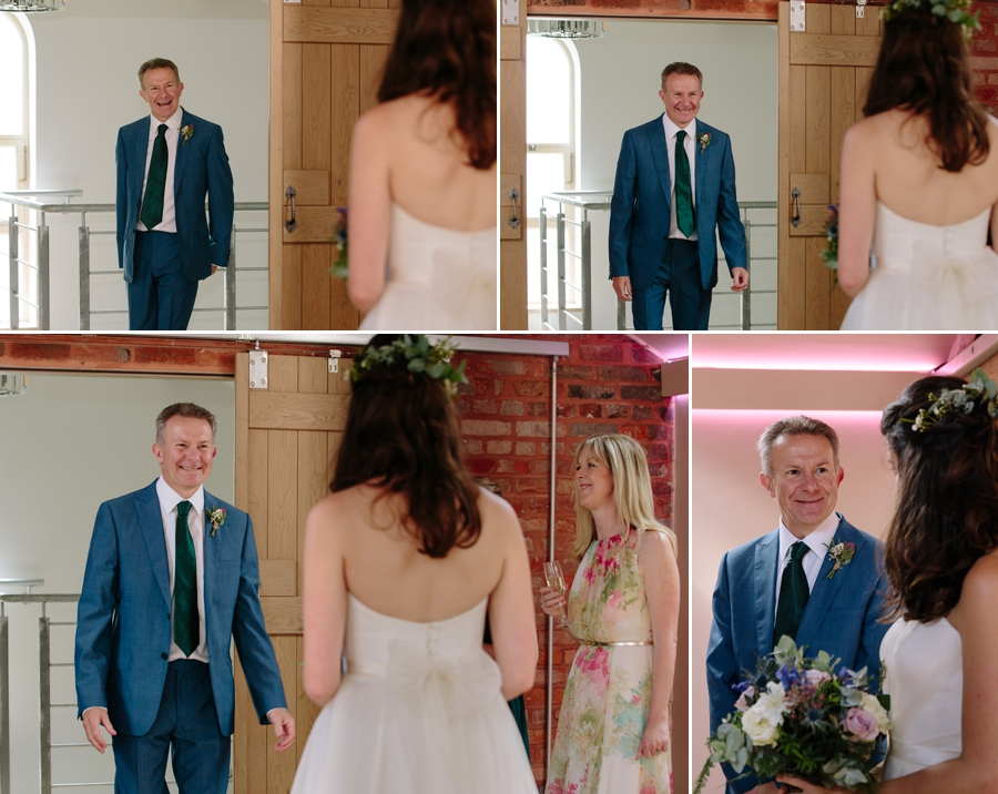 The first look of a father seeing his daughter in her wedding dress while mum looks on
