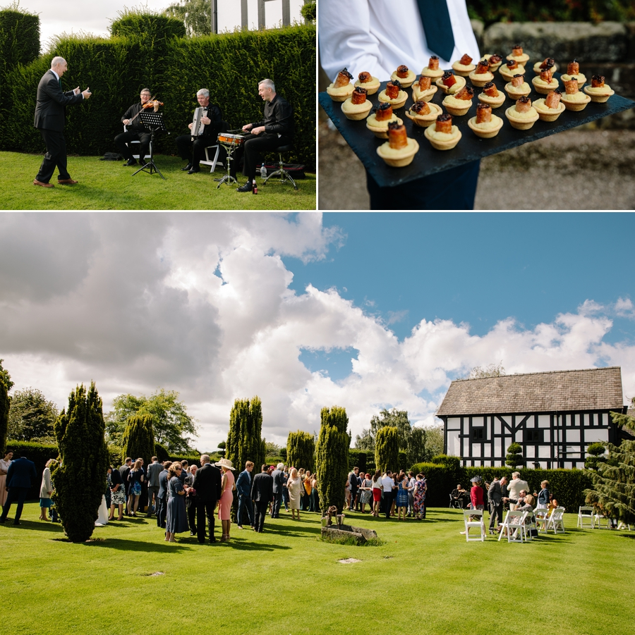 Guests enjoying the drinks reception in the stunning gardens at Holford Estate