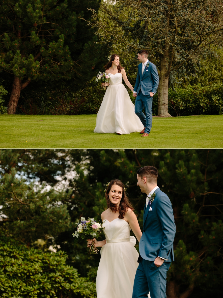 Bride and Groom walking through the gardens at Holford Estate