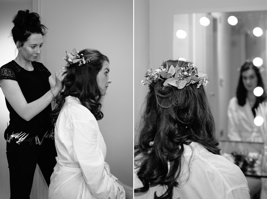 Bride having her hair styled and makeup applied on the morning of the wedding