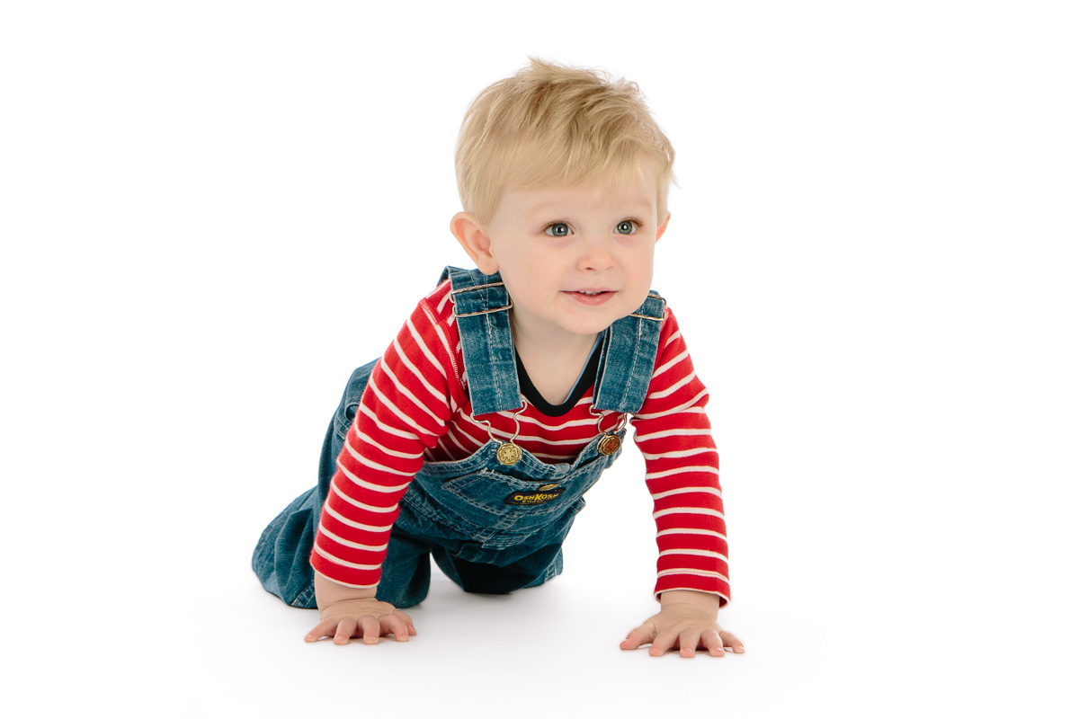 Little boy crawling and looking cute in studio