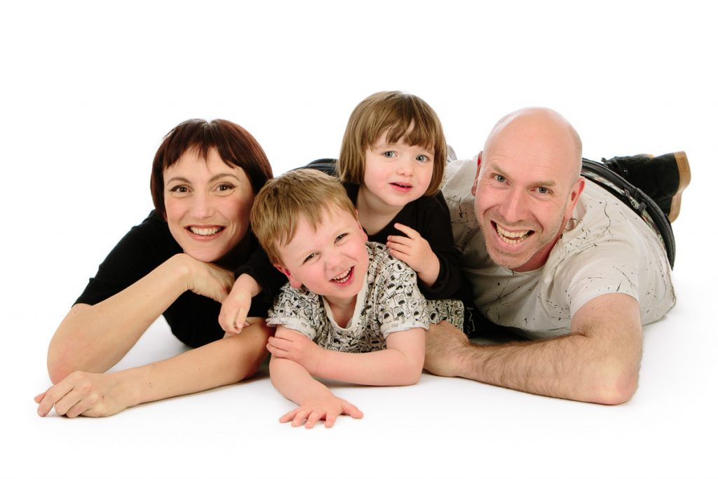 Parents and children laughing in studio
