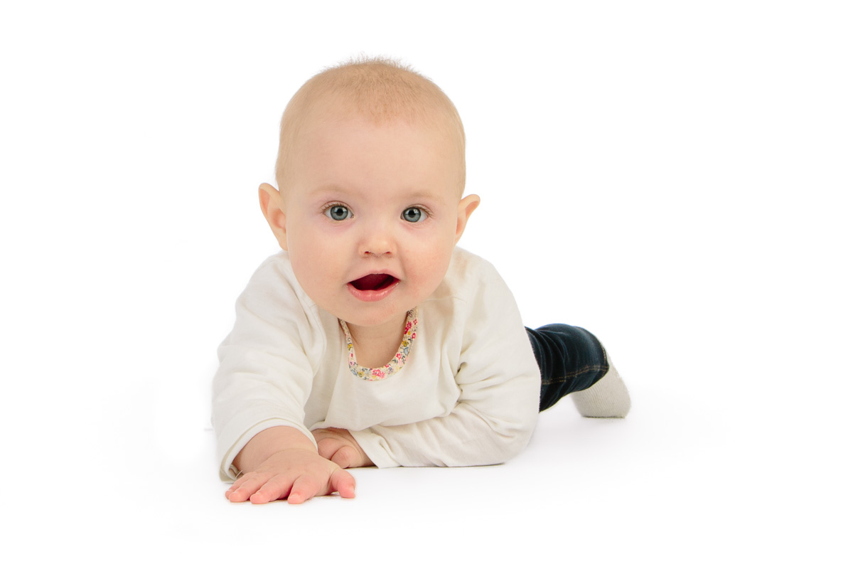 Cute baby crawling in studio