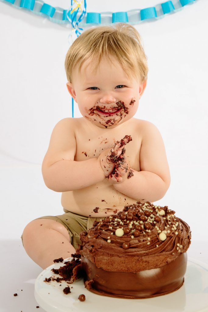Baby with cake smash having fun