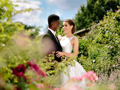 bride and groom on bright sunny day at Dorfold Hall