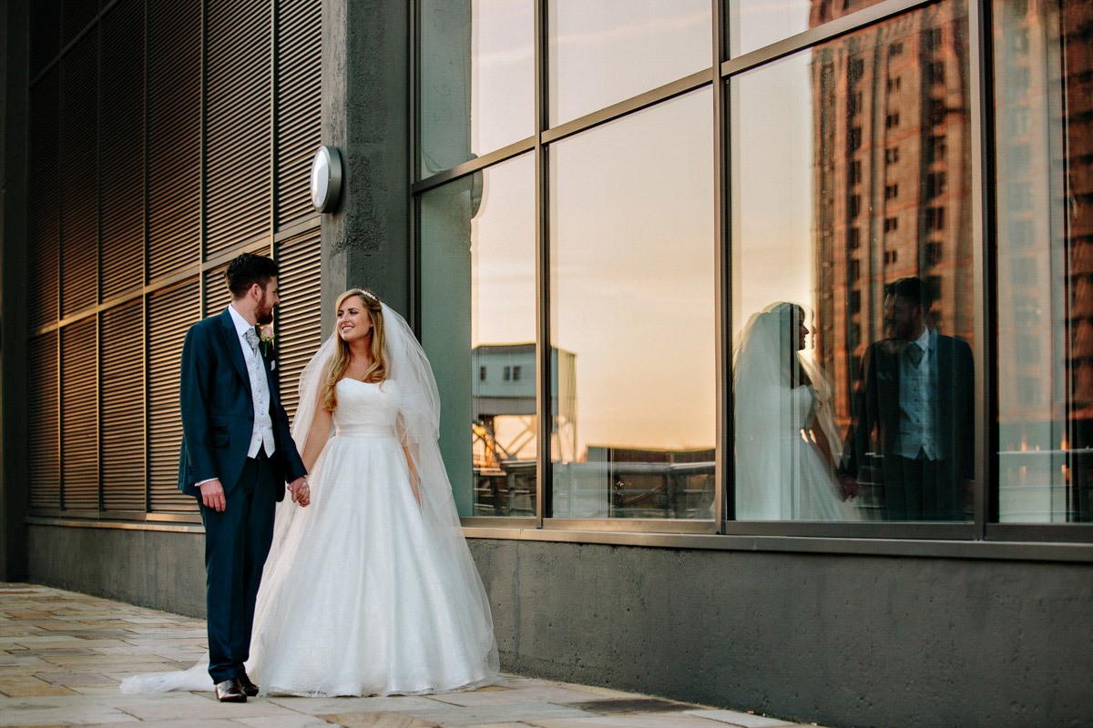 Bride and Groom with reflection at the Titanic Hotel in Liverpool
