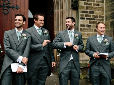 Groomsmen having a drink before the ceremony and laughing