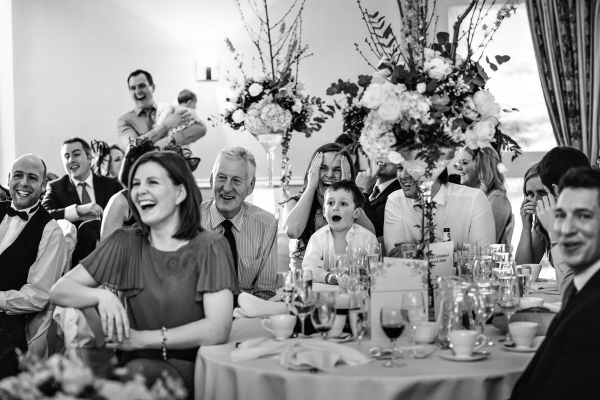 Wedding guests laughing during the wedding breakfast