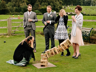 Wedding guests playing garden games and having fun