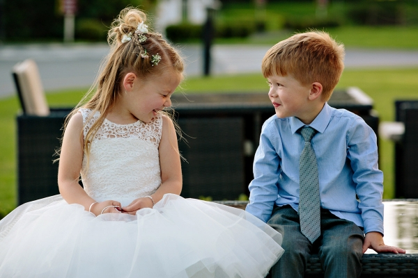 Flower girl and young boy together during the wedding