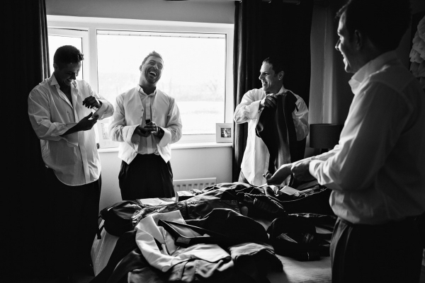 Groom and Groomsmen getting ready on the morning of the wedding